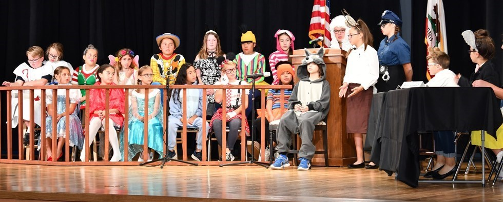 """Mickey Cox students performing on stage """"Goldilocks on Trial"""""""