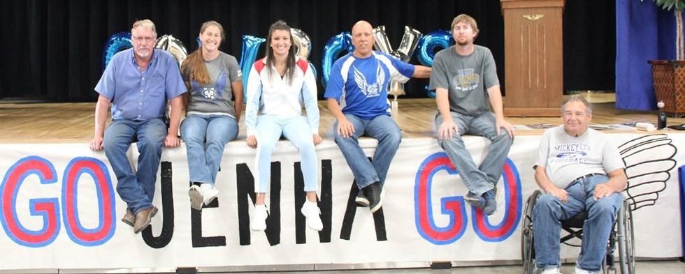 Jenna Prandini posing with Mickey Cox Staff