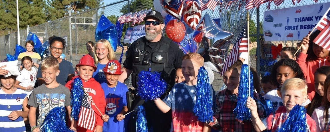 Picture of students with Clovis police celebrating his service on 9/11