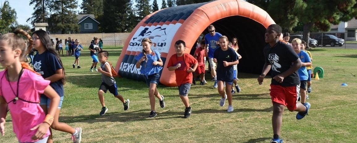 Students running for a fun raiser APEX.