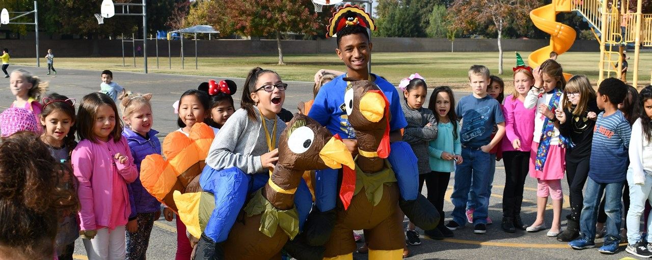 Mickey Cox students dressed up as turkeys