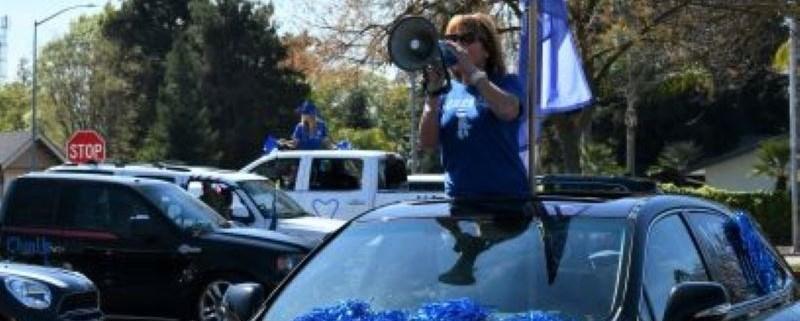 Principal in staff car parade