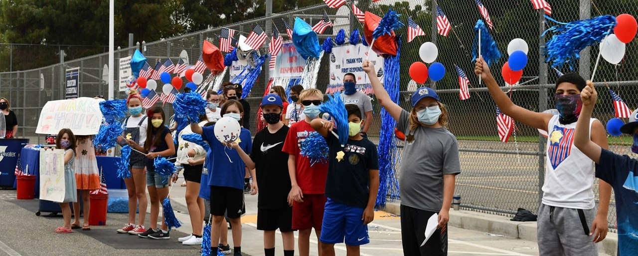 Children with poms celebrating first responders